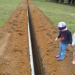 A young Vigneron checking out the new mainline for heatwave backup
